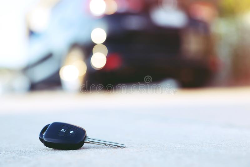 Abstract lost car keys fall lying on the street concrete. Cement ground roadway home front yard stock image