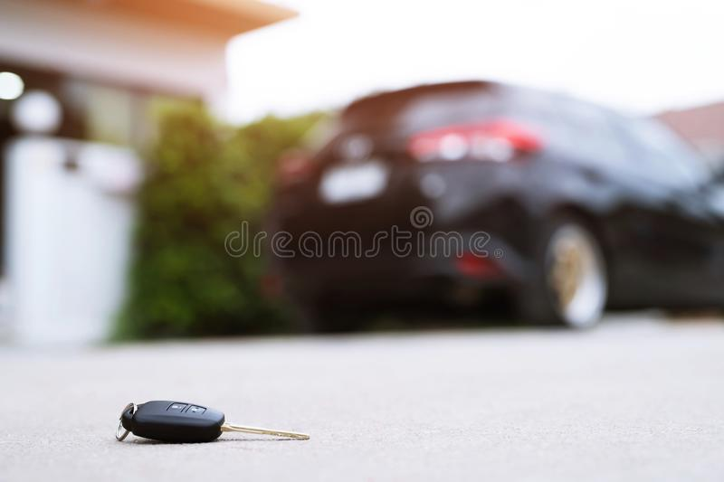 Abstract lost car keys fall lying on the street concrete cement ground roadway home front yard. transportation concept. royalty free stock image