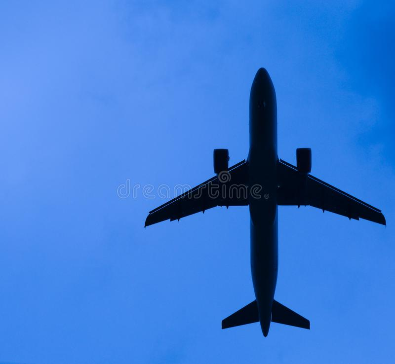 Abstract low flying airplane stock image