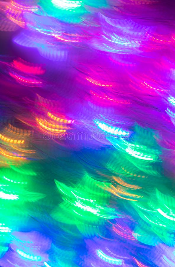 Abstract luminous seamless background of blurred multicolored neon lights. royalty free stock image