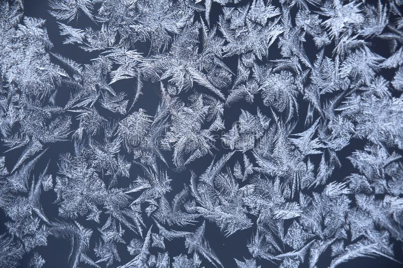 Abstract macro image of window frost flowers.  stock photography