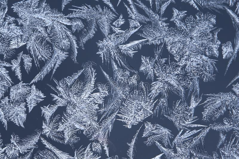 Abstract macro image of window frost flowers.  stock photo