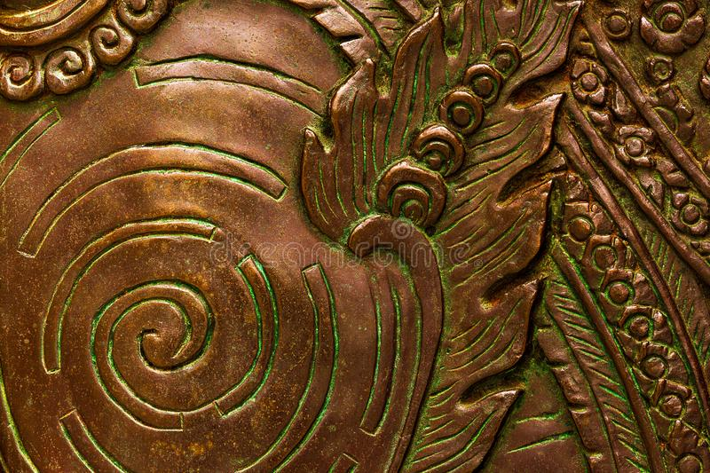 Abstract macro picture of bronze low relief art stock images