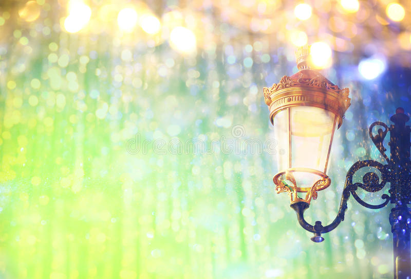 Abstract and magical image of Christmas street lights. With glitter overlay royalty free stock images