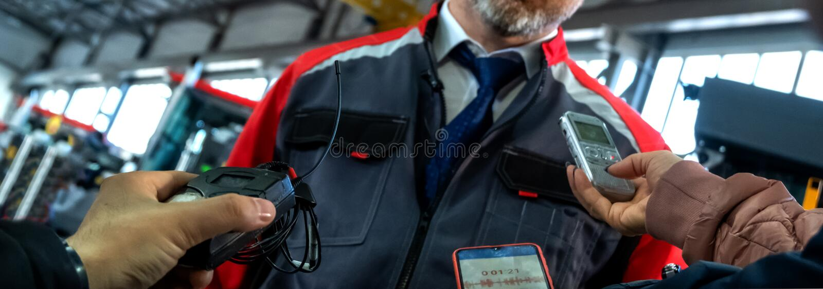 Abstract male worker or plant manager is interviewing reporters. Reporting media meeting and industry representative. Record. An abstract male worker or plant stock images