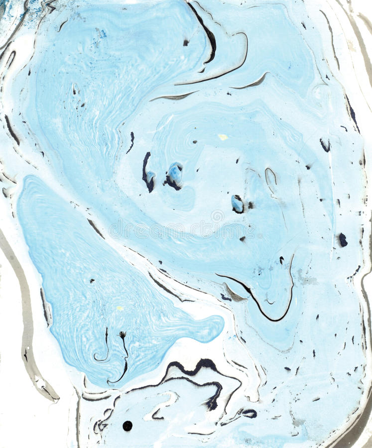 Abstract marble texture. Paper and mix of flowing ink. Pastel blue, black and white color mix. stock photography