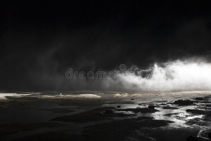 Abstract mars like terrain, muddy puddles of water textures, rocks, heavy fog. Abstract mars like terrain with muddy puddles of water textures, rocks and heavy royalty free stock photography