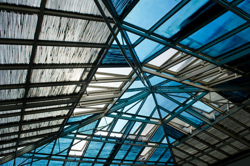 Abstract metal construction of roof with glass window royalty free stock photography