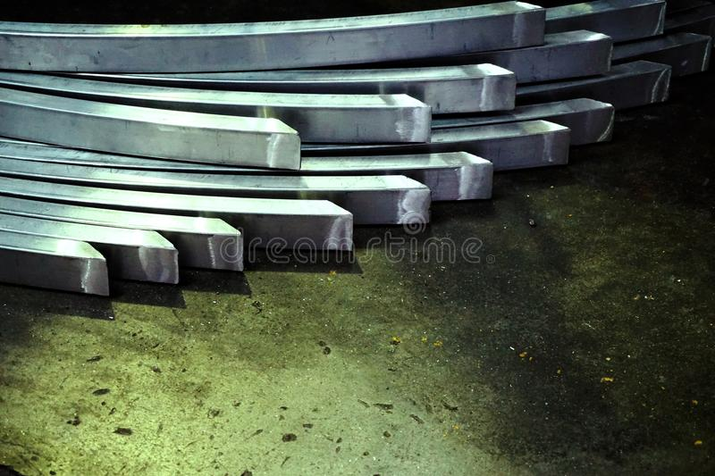 Abstract metal curve. Abstract stack of metal curve on the concrete floor stock image