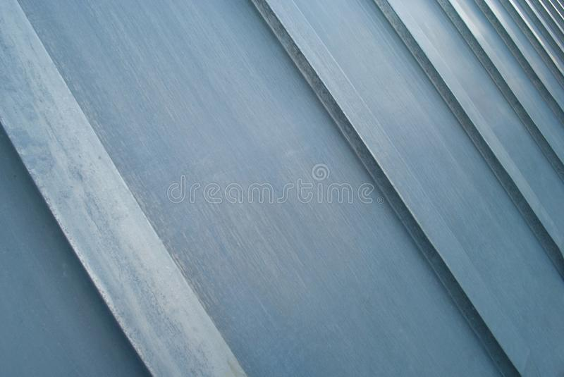 Abstract metallic bars, background, texture. Metallic surface of a modern building stock image