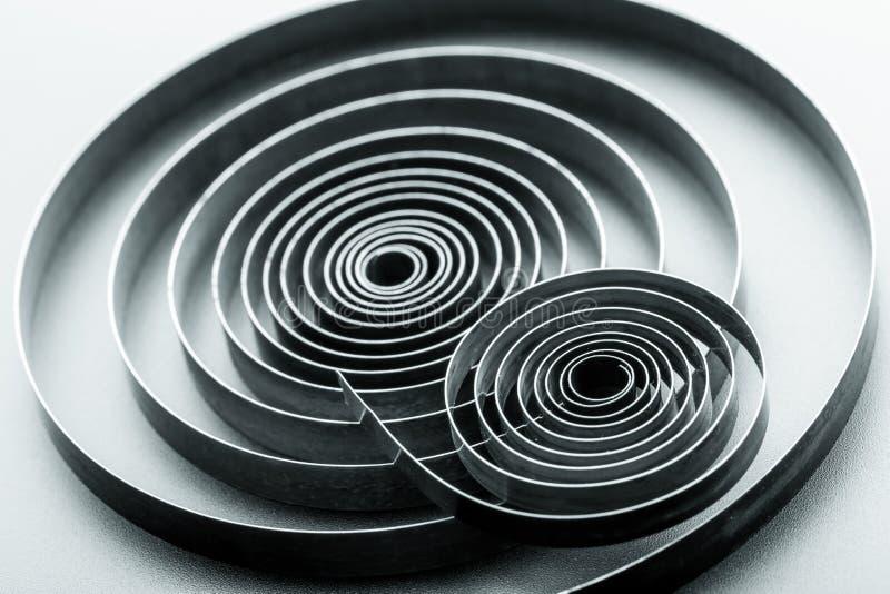 Abstract metallic spirals stock images