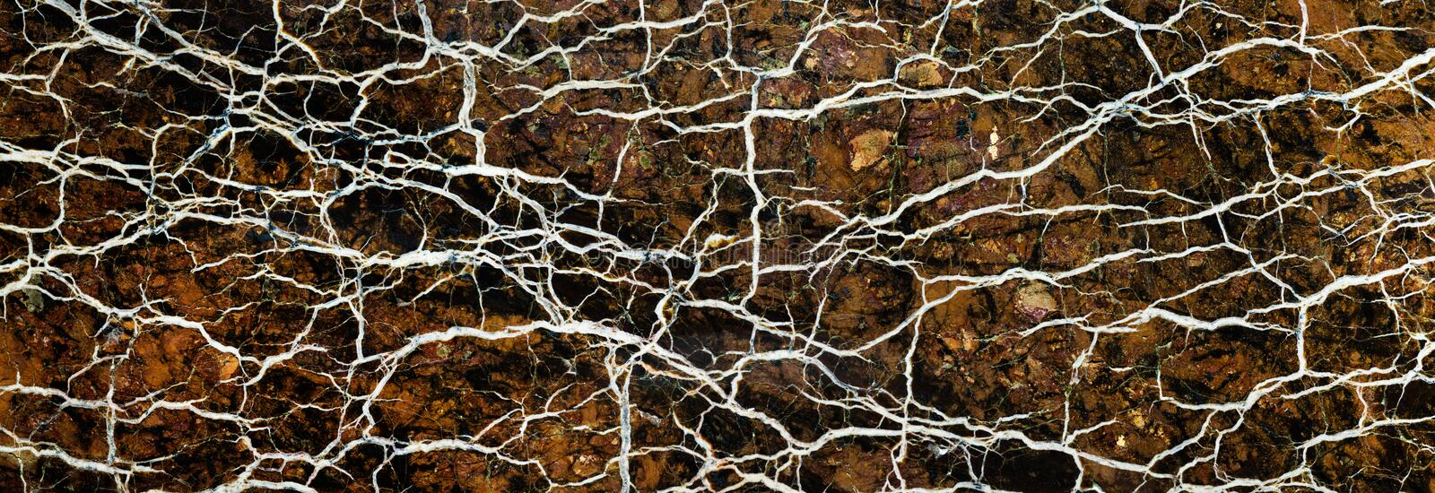 Abstract mineral texture. Backgrounds and textures: surface of beautiful brown-white decorative stone, abstract pattern of swirls, twirls, lines, cracks, spots stock image