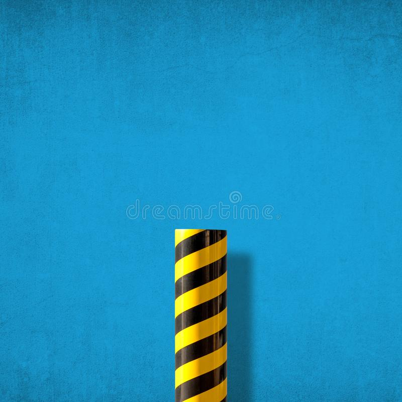 Abstract minimalist picture of road caution sign against blue wall. Road caution sign with diagonal yellow and black stripes against blue distressed wall stock photo