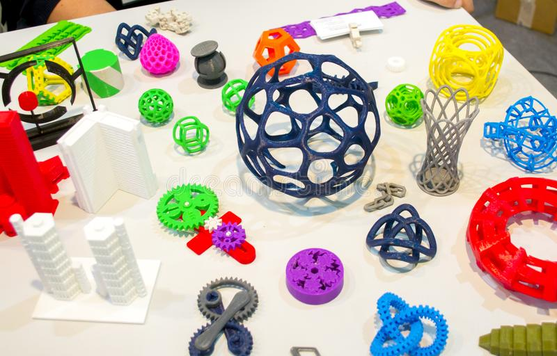 Abstract models printed by 3d printer close-up. Bright colorful objects printed on a 3d printer on a white table. Progressive modern additive technology royalty free stock photography