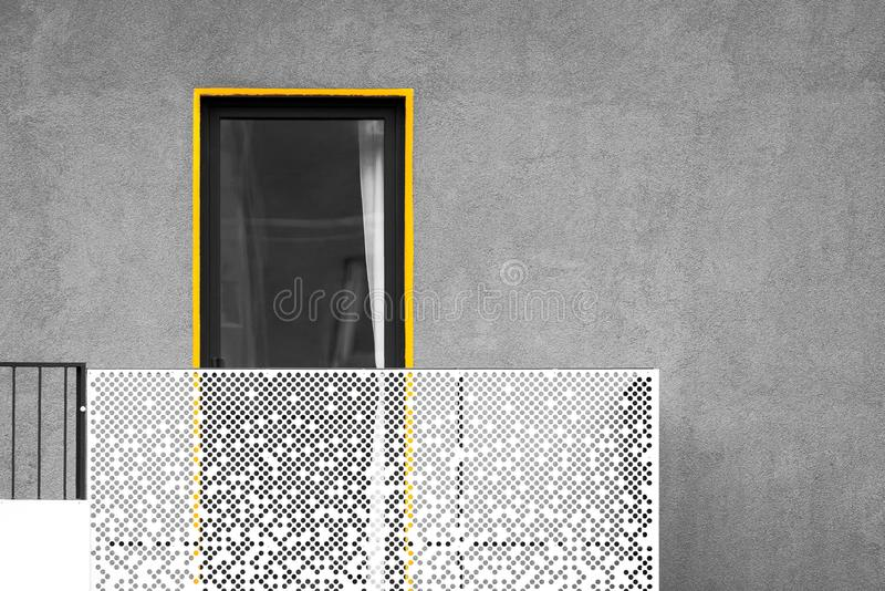 Abstract modern architecture with balcony and window. Black and white picture with yellow detail standing out stock image