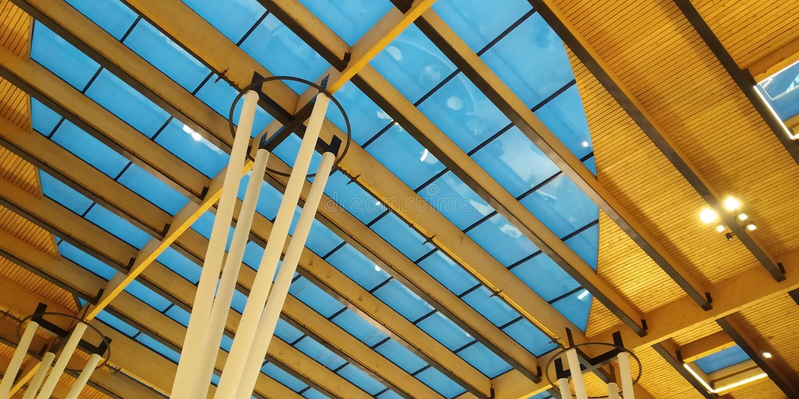 Abstract of modern architecture building interior. With strange angles and glass roof royalty free stock images