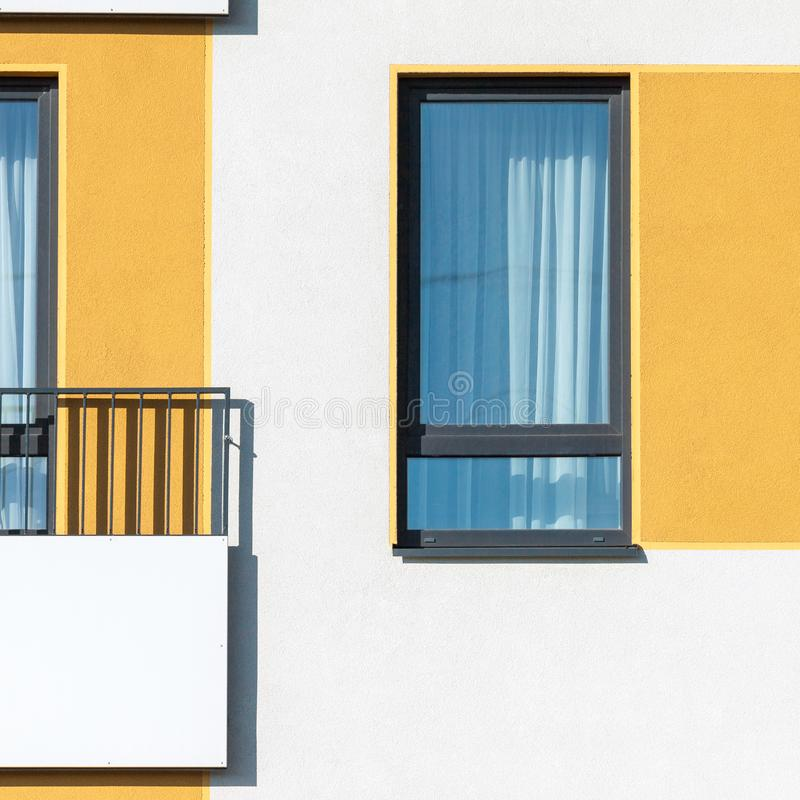 Abstract modern architecture picture with residential window and. Abstract modern architecture picture with high contrast colorful residential facade with window royalty free stock photos