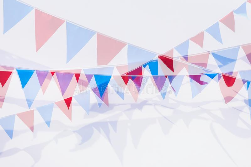 Abstract modern background from colorful garland of flags of triangular shape. Fest, celebration concept, banner design royalty free stock photos