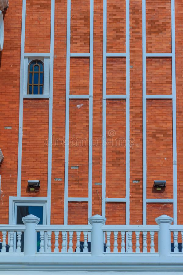 Abstract modern brick wall of the business building. Old orange stock images