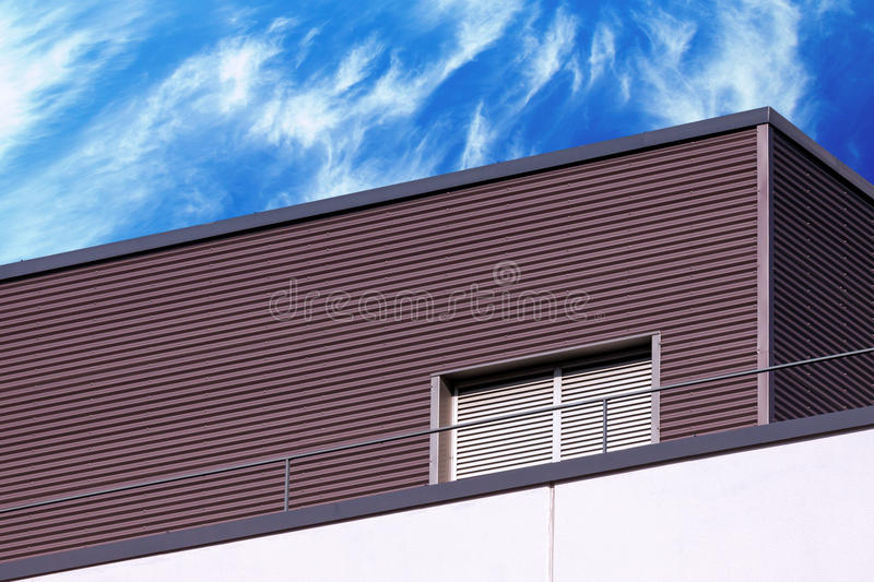 Abstract modern building detail and cloudy sky. Abstract looking modern building detail against blue cloudy sky stock images