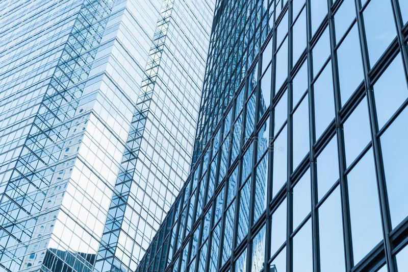 Abstract modern business architecture fragment. Walls made of glass and steel with reflections of blue cloudy sky stock photos