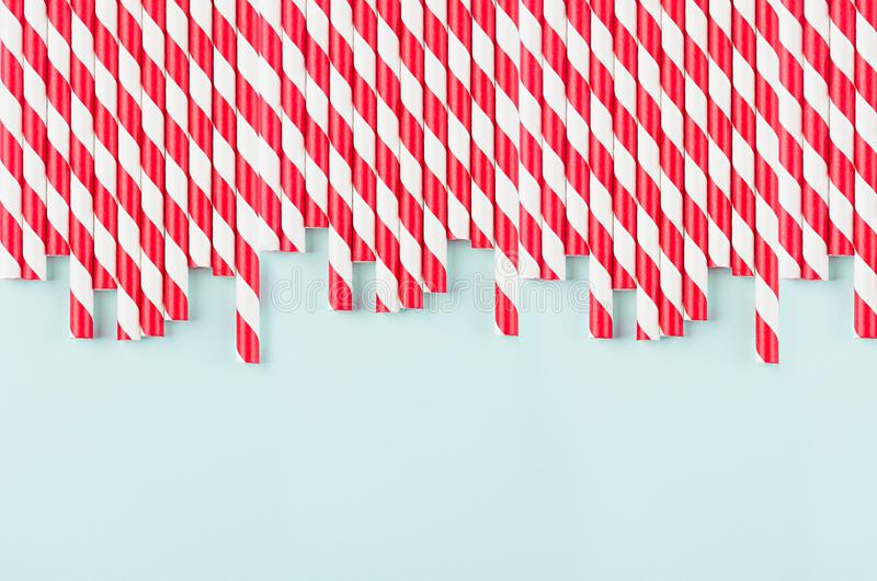 Abstract modern fashion background - red and white striped straws as border pattern on light mint background. Abstract modern fashion background - red and white royalty free stock photos