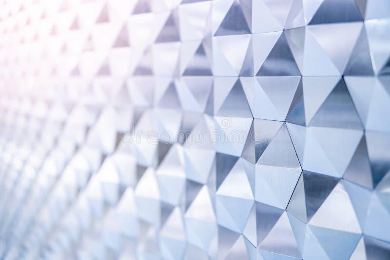 Abstract modern metallic triangular wall pattern royalty free stock image