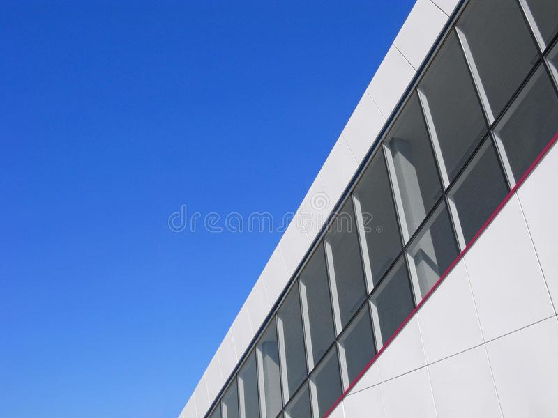 Abstract modern white building and blue sky, copy space royalty free stock image