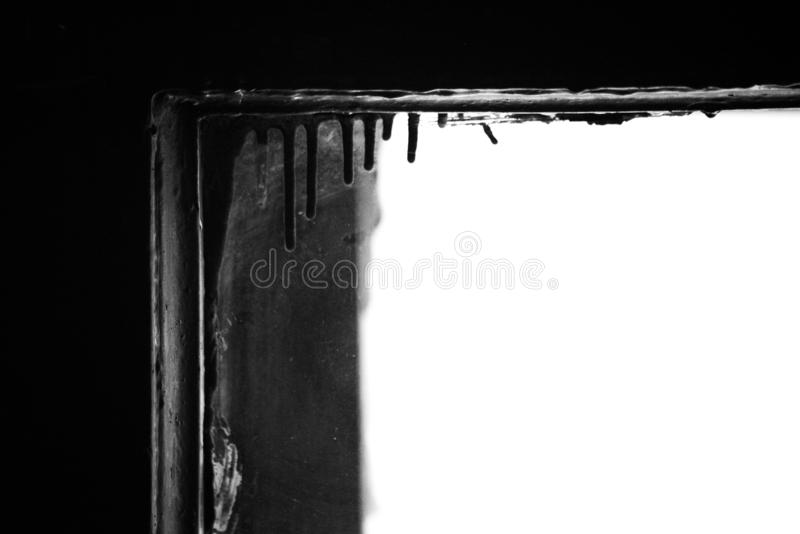Abstract monochrome contrasting background with stained and dried paint on the window frame. Abstract black and white contrasting background with stained and stock image