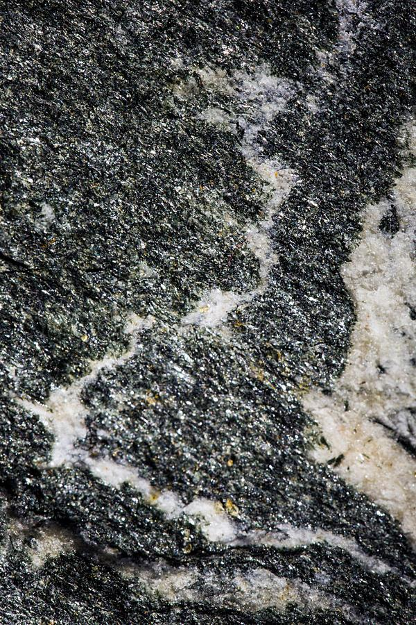 Closeup of fractured stone. Abstract monochrome textured background created by surface of a fractured stone royalty free stock images