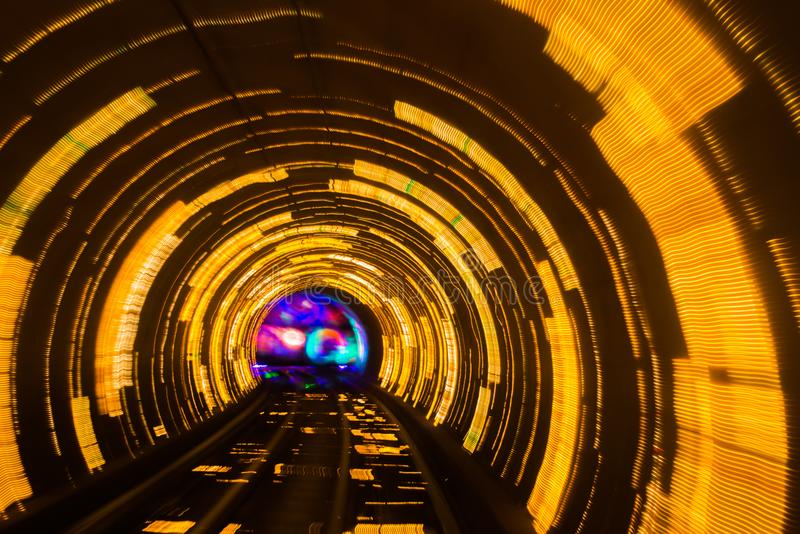 Abstract motion background tunnel turning right. Abstract motion background sparkling light waves in deep tunnel turning right stock image