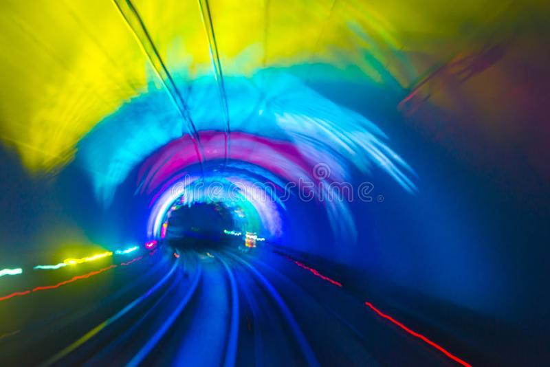 Abstract motion speed railway tunnel. With city background royalty free stock image
