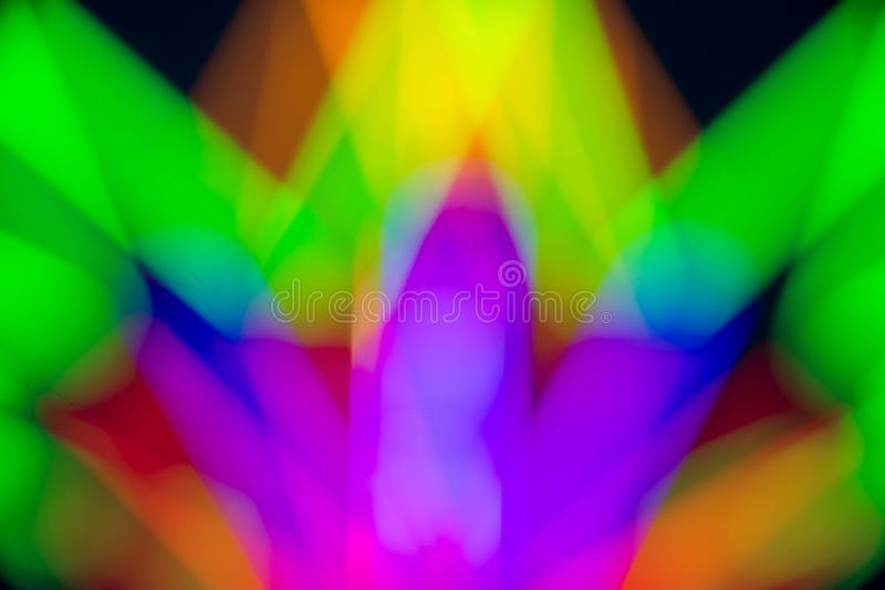 Abstract multi color of glow fluorescent on black background. Neon light tube lamp design bright party fluorescence love led blue dark night uv disco red green stock photography