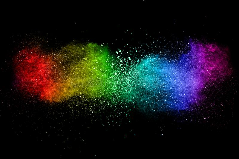 Abstract multi color powder explosion on black background. Freeze motion of color dust particles splash. Painted Holi in festival royalty free stock photography