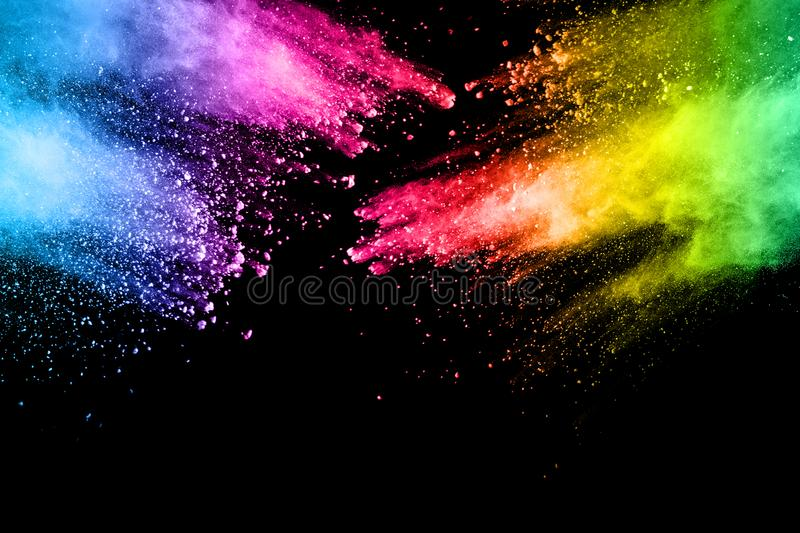 Abstract multi color powder explosion on black background. stock image