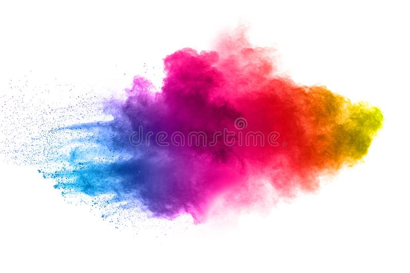 Abstract multi color powder explosion on white background. Freeze motion of dust particles splashing. Painted Holi in festival royalty free stock photos