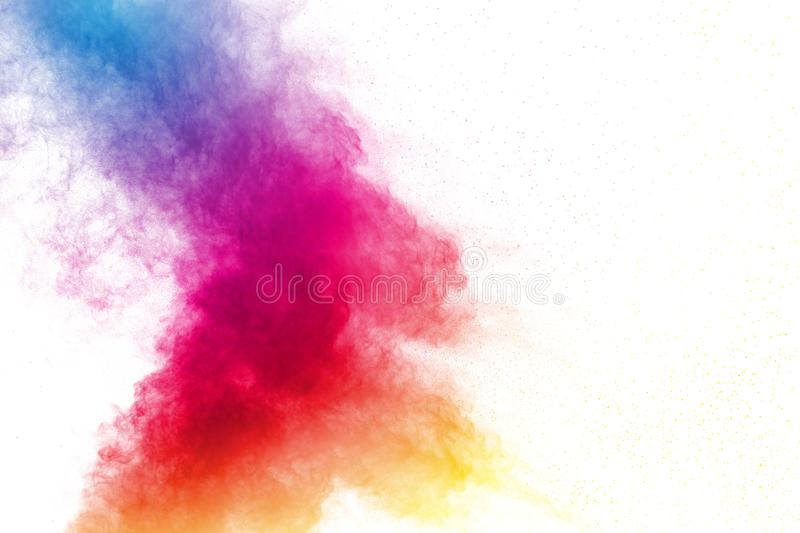 Abstract multi color powder explosion on white background. royalty free stock photos