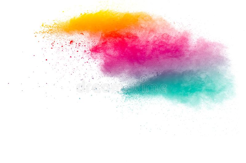 Abstract multi color powder explosion on white background. Freeze motion of color dust particles splashing. Painted Holi in festival royalty free stock photo