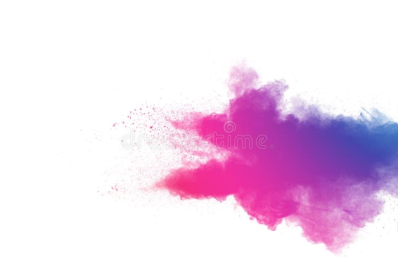 Abstract multi color powder explosion on white background.Freeze motion of dust particles splash stock image