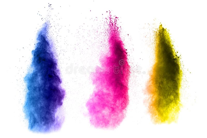 Abstract multi color powder explosion on white background stock photography