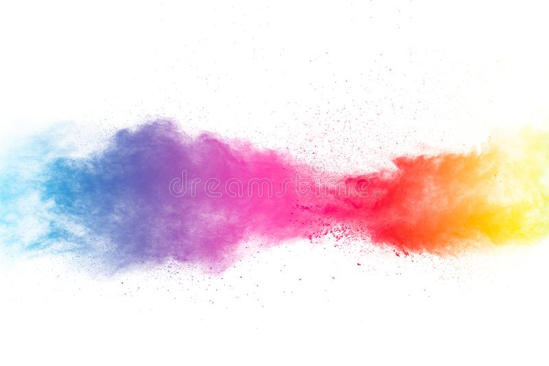 Abstract multi color powder explosion on white background. Freeze motion of color dust particles splashing. Painted Holi in festival royalty free stock photography