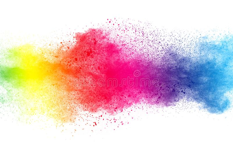 Abstract multi color powder explosion on white background. Freeze motion of dust particles splashing. Painted Holi in festival royalty free stock image