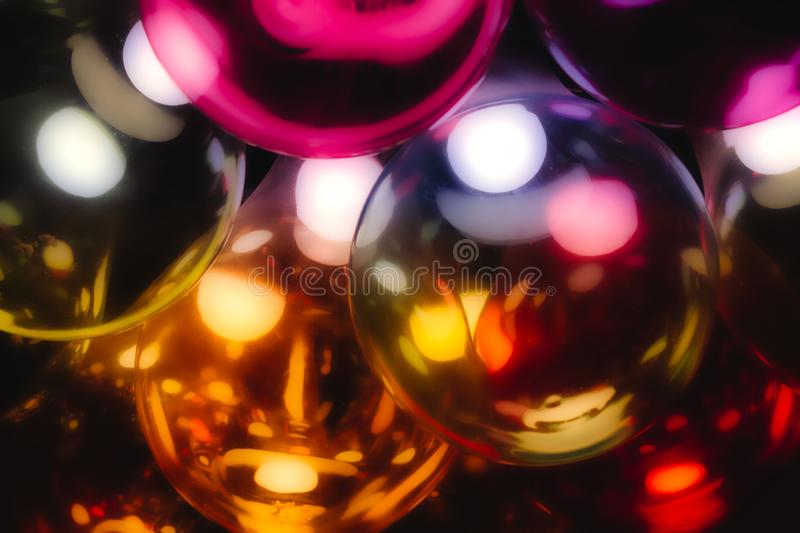 Abstract multi-colored glass light bulbs with a warm glow stock photo