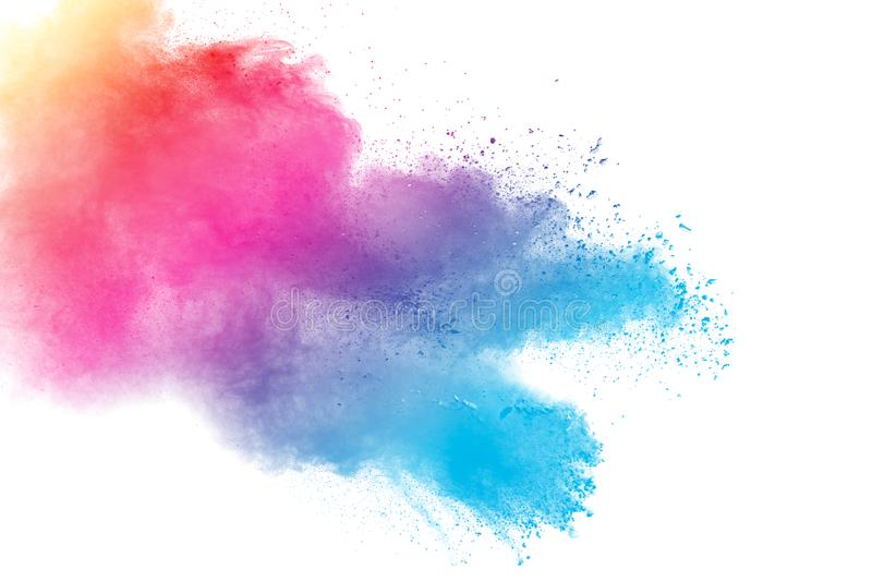 Abstract multicolored dust explosion on white background. stock photo