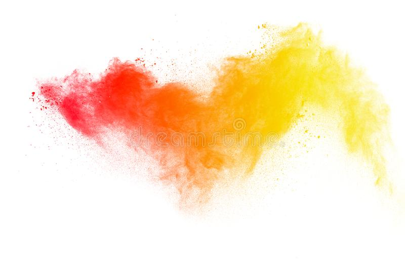 Abstract multicolored dust explosion on white background. royalty free stock photo