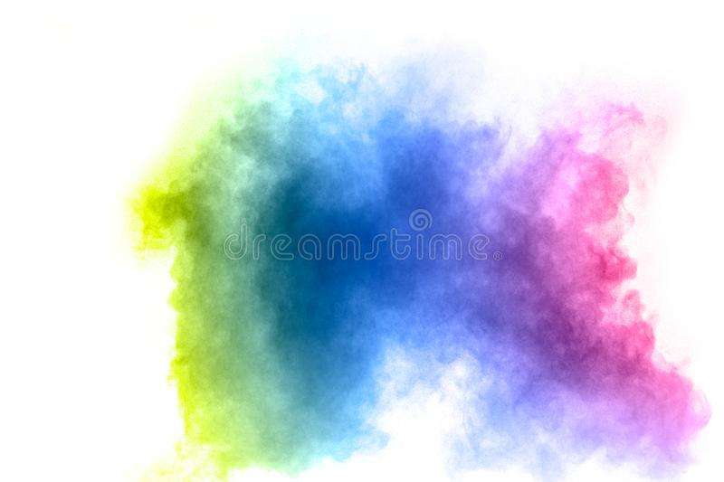 Abstract multicolored dust splash on white background. Bizarre form of colorful powder explosion on white background stock photos