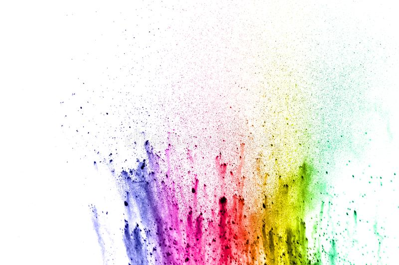 Abstract multicolored dust splatter on white background. Freeze motion of color powder explosion on white background stock photography