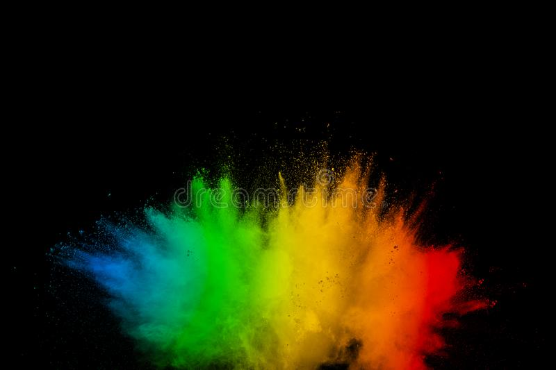Abstract multicolored powder explosion on black background. Color dust particle splattered on background royalty free stock photos