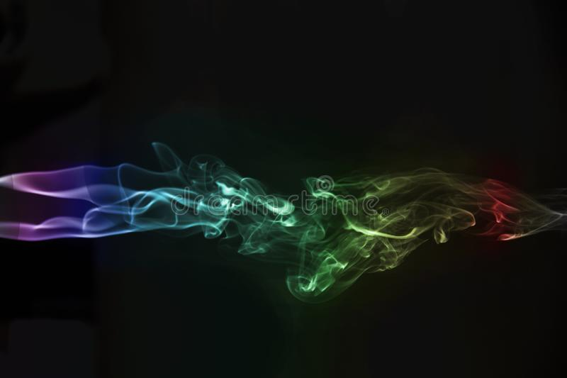 beautiful multicolored abstract smoke on black background stock photos