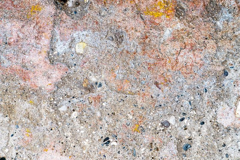 Multicolored texture on the cement wall stock photo